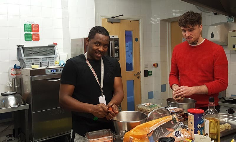 Harun and Aaron doing veg prep